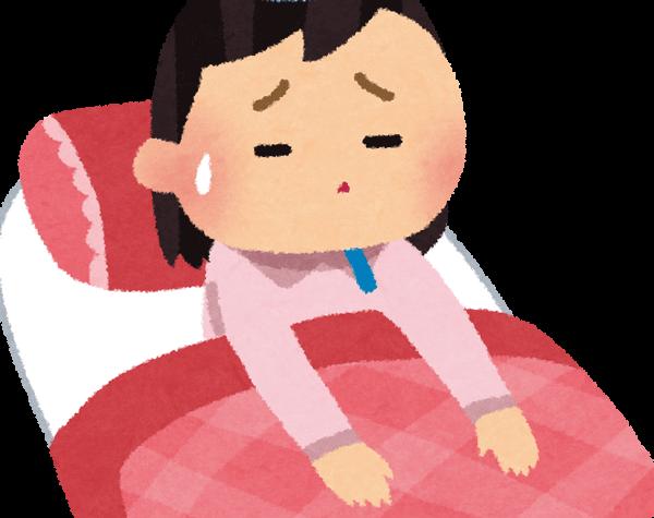 風邪で寝る女性